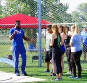 Kibwe Joahson conducts youth hammer throwing clinic