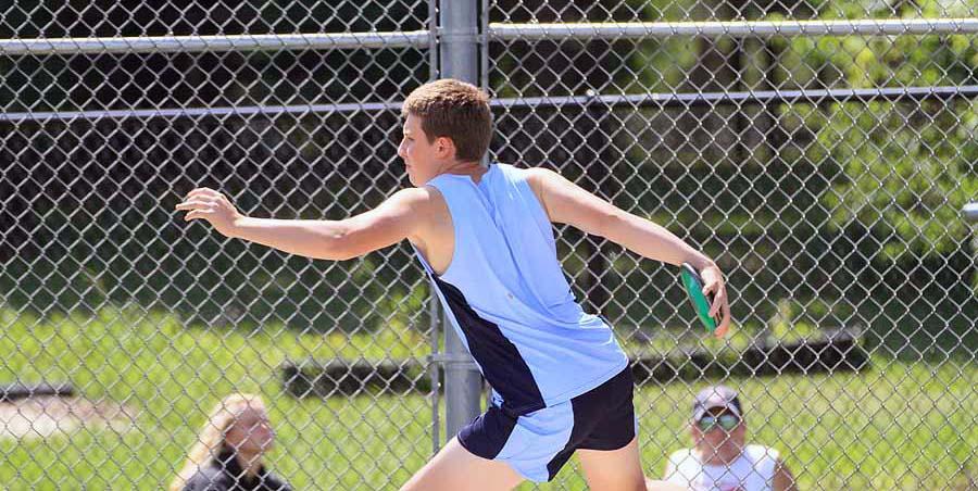 Dan Coxworth competes in the discus event